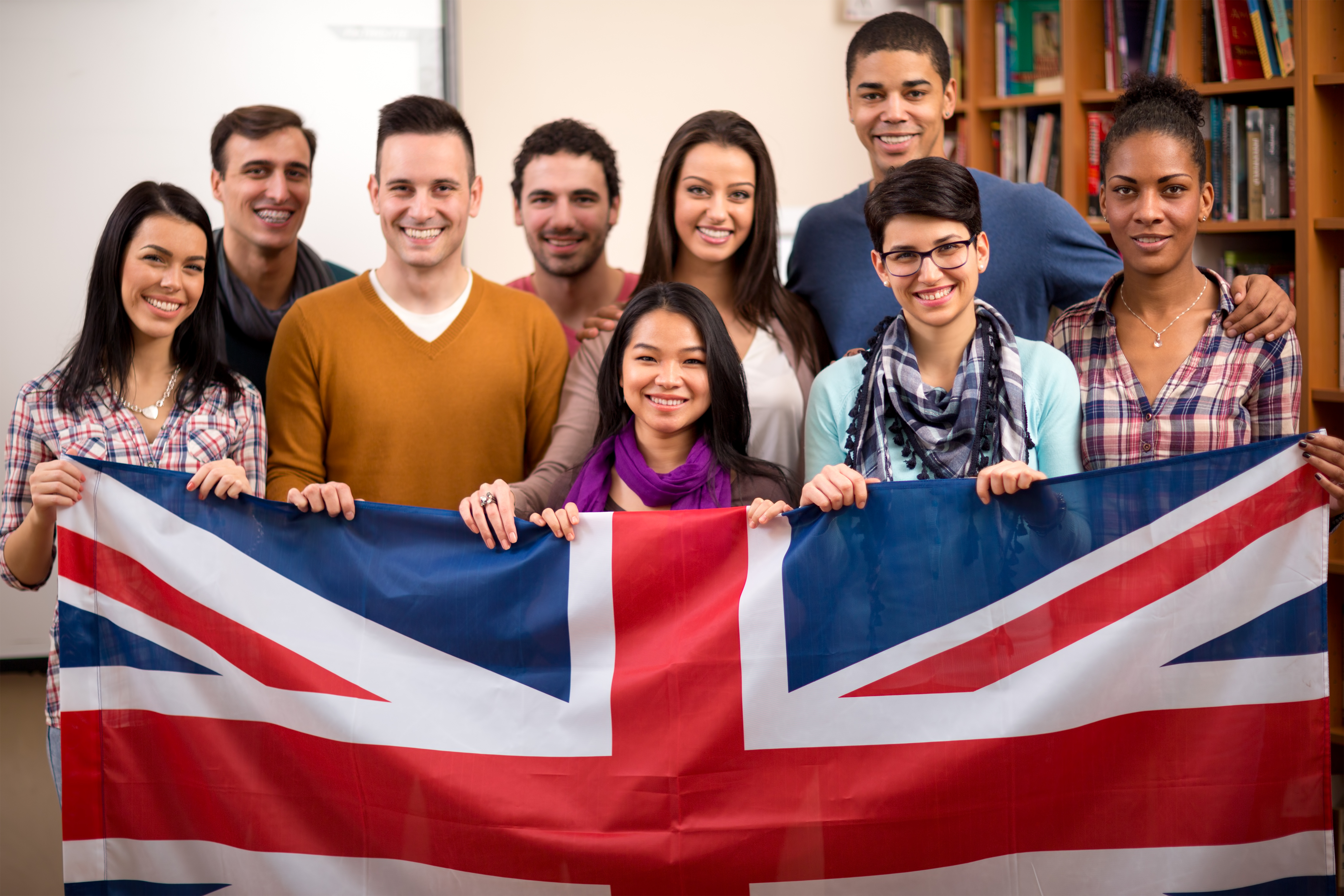 Group of British students presents their country and hold the flag
